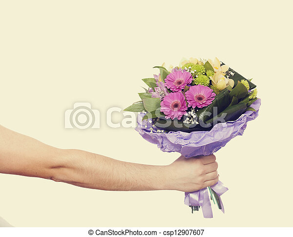 hand with a flowers isolated on white - csp12907607