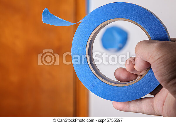 Hand with blue masking tape - csp45755597