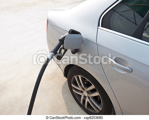 hand with fill up fuel at gas stati - csp8253680