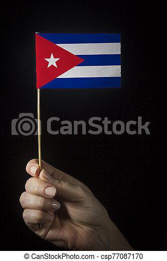 Hand with flag of Cuba - csp77087170