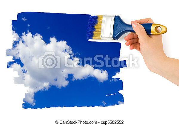 Hand with paintbrush painting sky - csp5582552