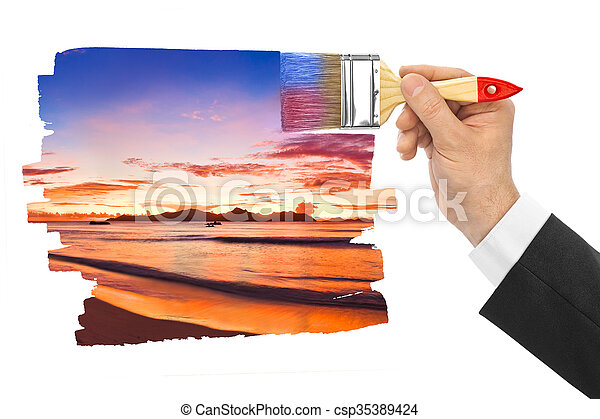 Hand with paintbrush painting sunset - csp35389424