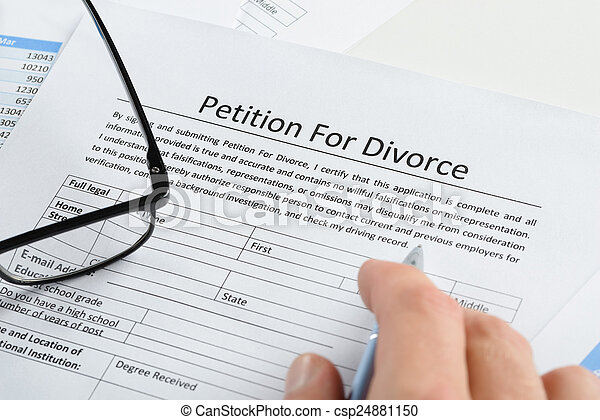 Hand With Pen On Petition For Divorce Paper - csp24881150
