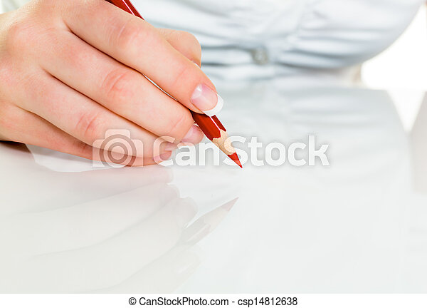 hand with red pencil - csp14812638