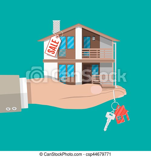 Hand With Small House Keys And Price Tag