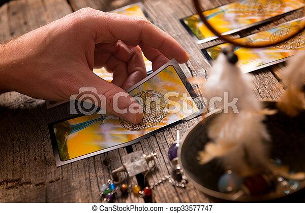 Hand with tarot cards - csp33577747