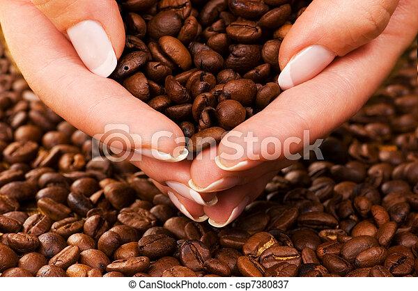 Handful of premium coffee beans - csp7380837