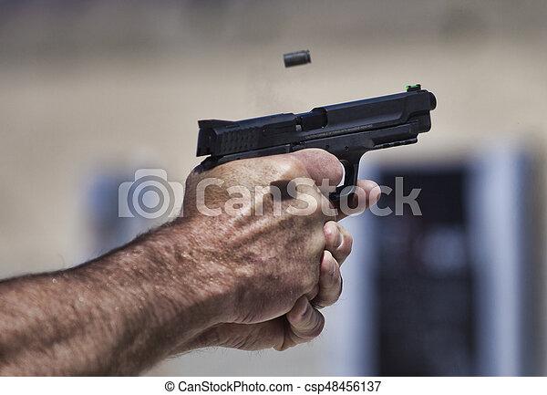 Handgun being shot - csp48456137