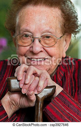 Handicapped senior citizen walking stick with a smile - csp3927646