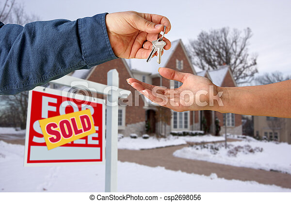 Handing Over the House Keys in Front of New Home - csp2698056
