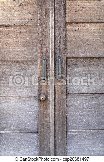 Handle on wooden door - csp20681497
