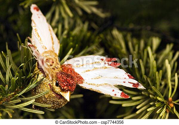 Handmade bird in christmas tree - csp7744356