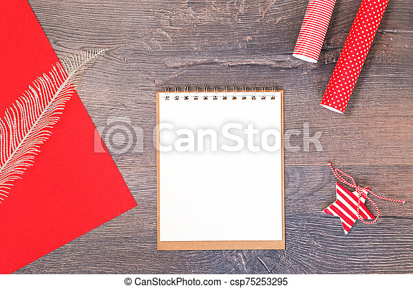 Handmade Christmas star and red gift wrapping paper and notebook - csp75253295
