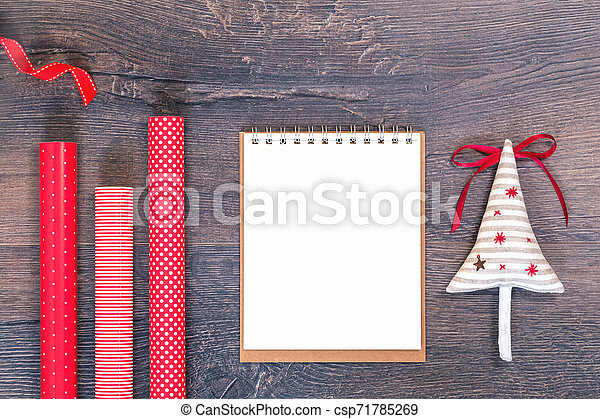 Handmade Christmas tree and red gift wrapping paper and notebook - csp71785269