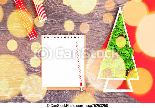 Handmade Christmas tree and red gift wrapping paper with light - csp75253258
