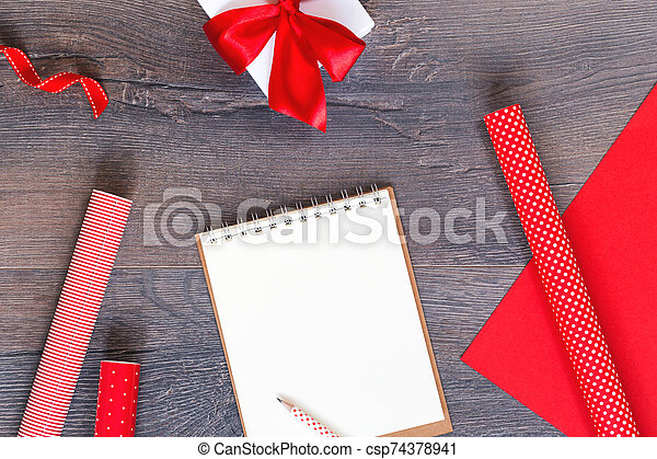 Handmade Christmas tree and red gift wrapping paper and notebook - csp74378941