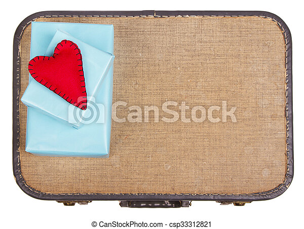 Handmade felt hearts sitting on presents on top of a suitcase - csp33312821
