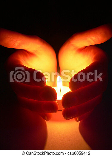 Hands and a candle - csp0059412