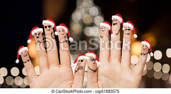 Hands and fingers in santa hats at christmas. Christmas, holidays ...