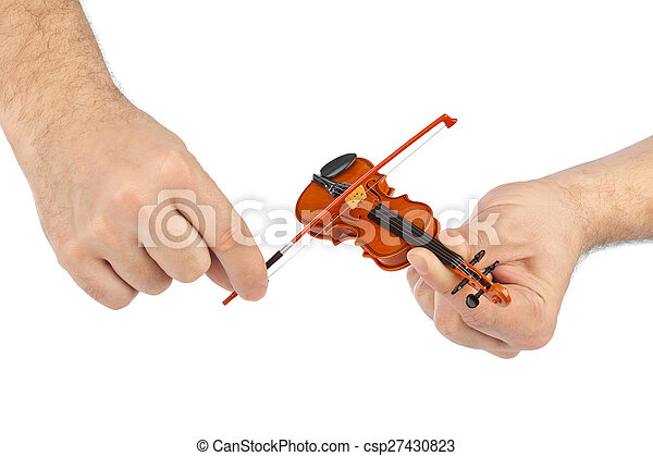 Hands and toy violin - csp27430823