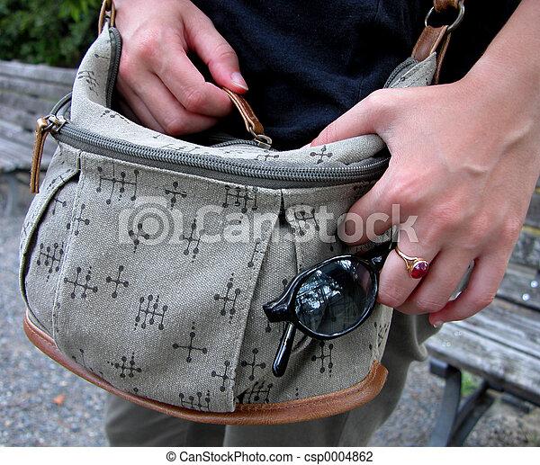 Hands closing a bag - csp0004862