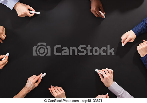 Hands Drawing With Chalk On Blackboard - csp48133671