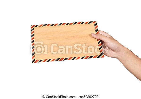 Hands holding brown envelope - csp60362732