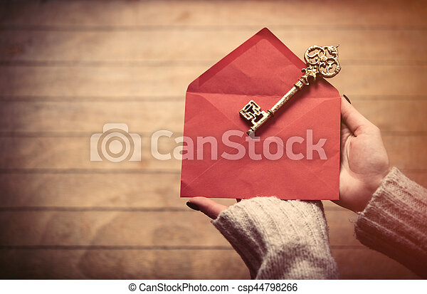 hands holding envelope and key - csp44798266