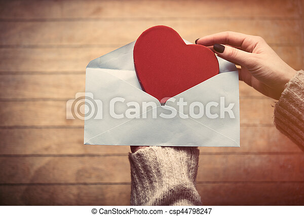 hands holding envelope and toy - csp44798247