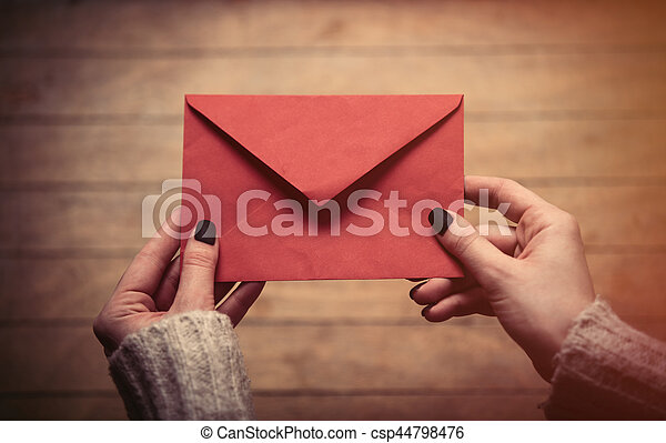 hands holding envelope - csp44798476