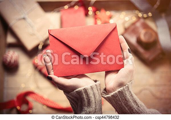 hands holding envelope - csp44798432