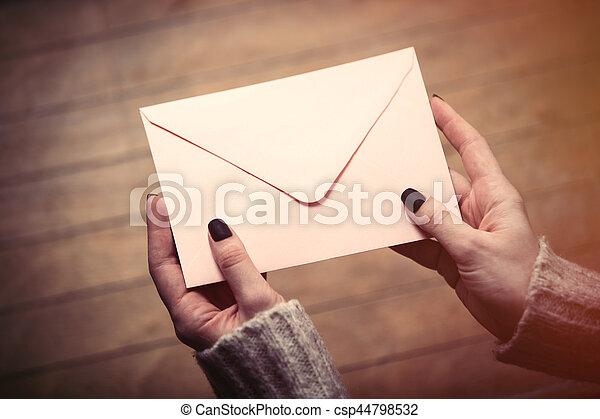 hands holding envelope - csp44798532