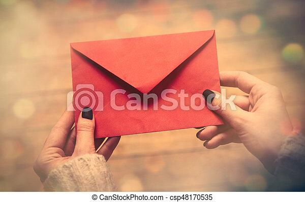 hands holding envelope - csp48170535