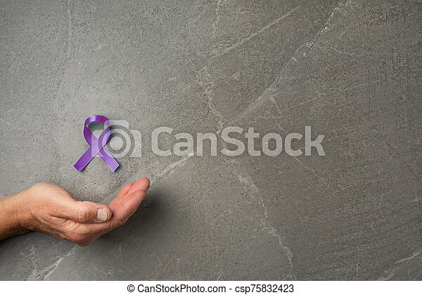 Hands holding purple ribbons top view - csp75832423