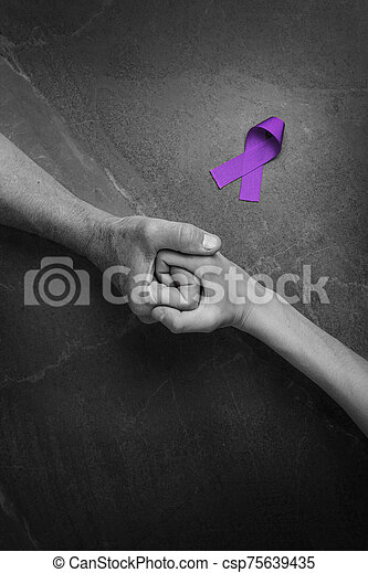 Hands holding purple ribbons top view - csp75639435