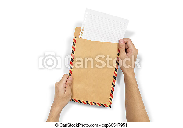 Hands insert the paper into brown envelope - csp60547951