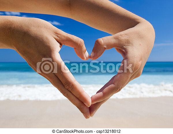 Hands making a heart shape - csp13218012