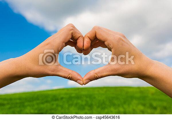Hands making a heart shape - csp45643616