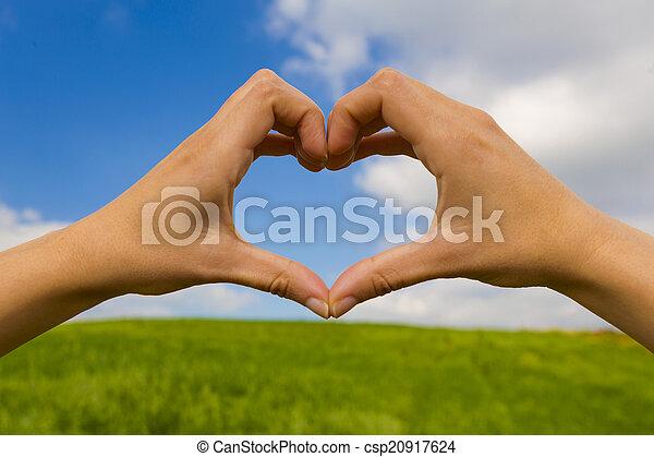 Hands making a heart shape - csp20917624