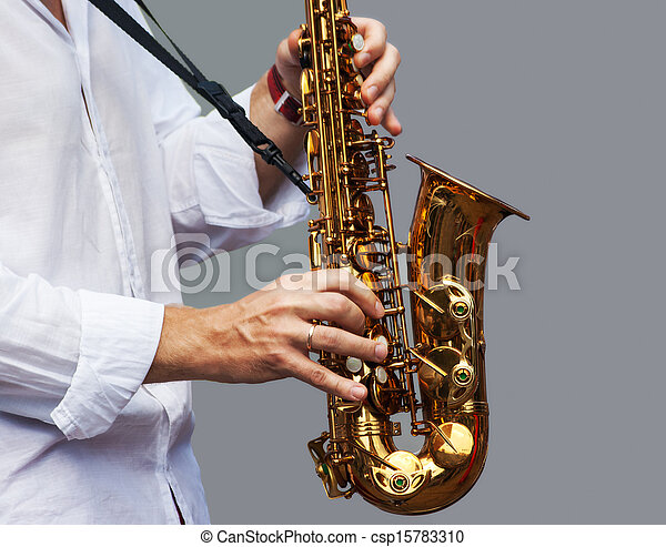 hands of a musician with the saxophone - csp15783310