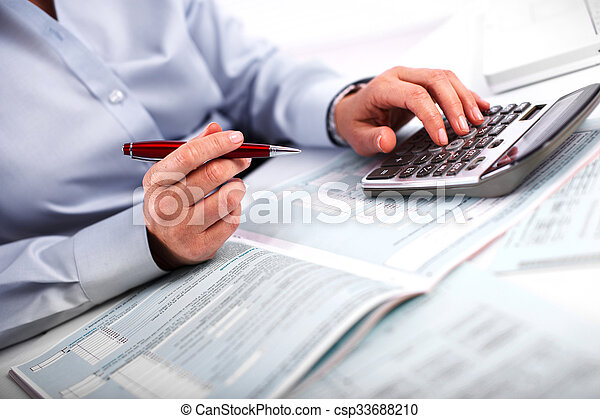 Hands of accountant business woman with calculator. - csp33688210