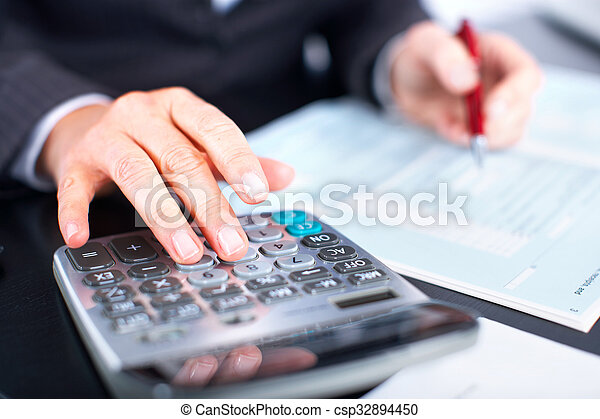 Hands of accountant business woman with calculator. - csp32894450