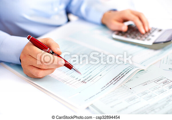 Hands of accountant business woman with calculator. - csp32894454