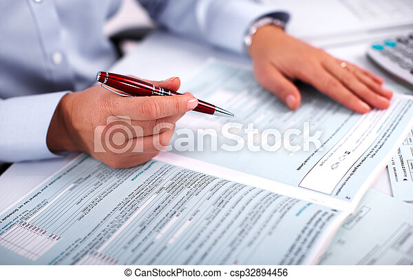 Hands of accountant business woman with calculator. - csp32894456