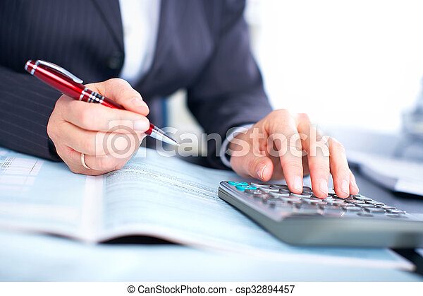 Hands of accountant business woman with calculator. - csp32894457