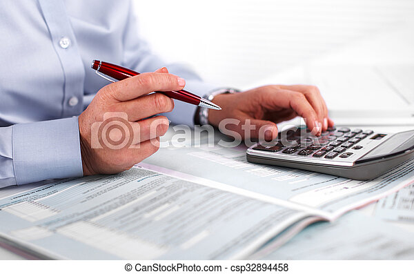 Hands of accountant business woman with calculator. - csp32894458