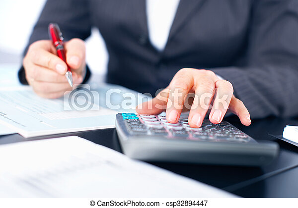 Hands of accountant business woman with calculator. - csp32894447