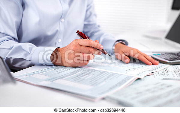 Hands of accountant business woman with calculator. - csp32894448