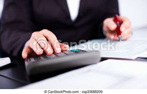 Hands of accountant business woman with calculator. - csp33688209