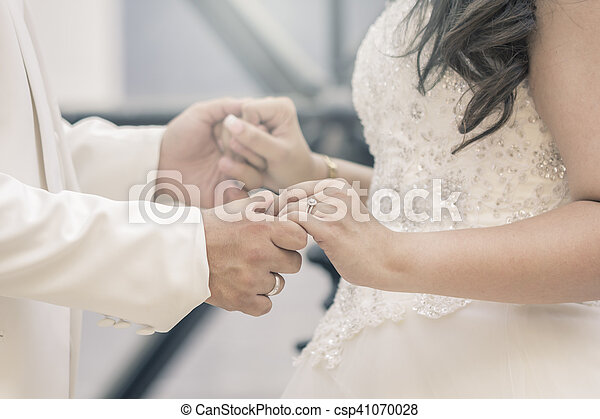 Hands of bride and groom with rings - csp41070028